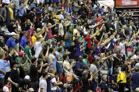 Fans cheer for their team during the Vegas Summer League game between the Washington Wizard the ...