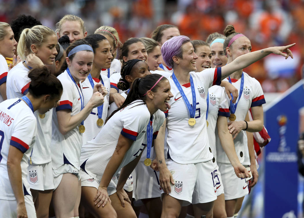Megan Rapinoe, center, celebrates the U.S. team's victory with teammates after the Women's Worl ...