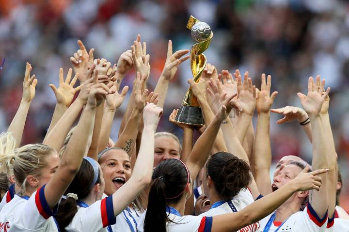 U.S. players celebrate their victory in the Women's World Cup final soccer match over the Nethe ...