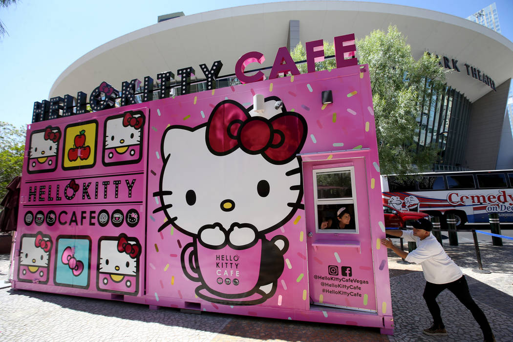 Hello Kitty Cafe owner Polo Nguyen, right, and Business Development Coordinator Melissa Paez pr ...