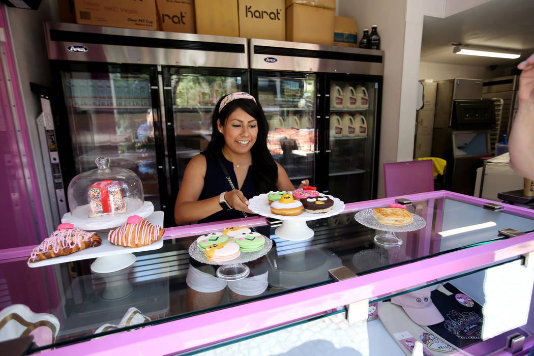 Hello Kitty Cafe Business Development Coordinator Melissa Paez prepares for a media preview for ...