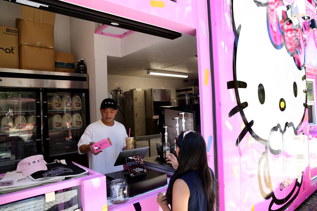 Hello Kitty Cafe owner Polo Nguyen, left, and Business Development Coordinator Melissa Paez dur ...