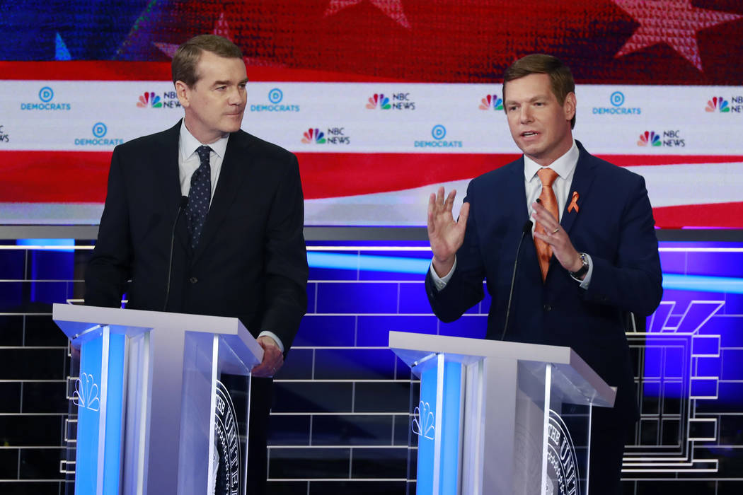 Democratic presidential candidate Rep. Eric Swalwell, D-Calif., right, speaks during the Democr ...