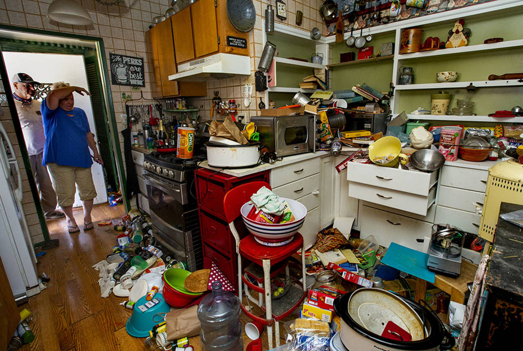 Zana Eisenhour and her husband Charlie look to their damaged kitchen from earthquake activity i ...
