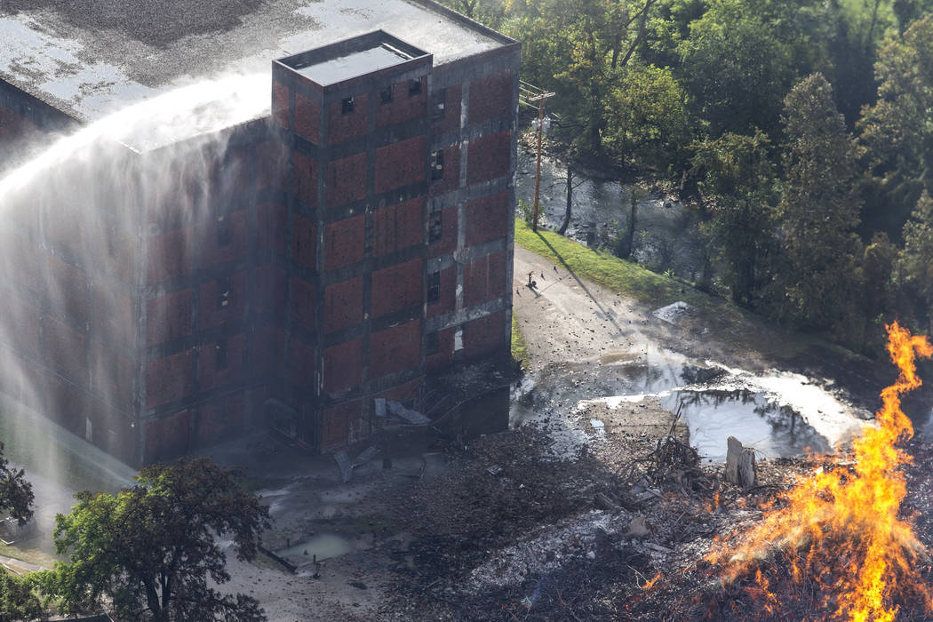 Flames and smoke rise from a bourbon warehouse fire at a Jim Beam distillery in Woodford Count ...