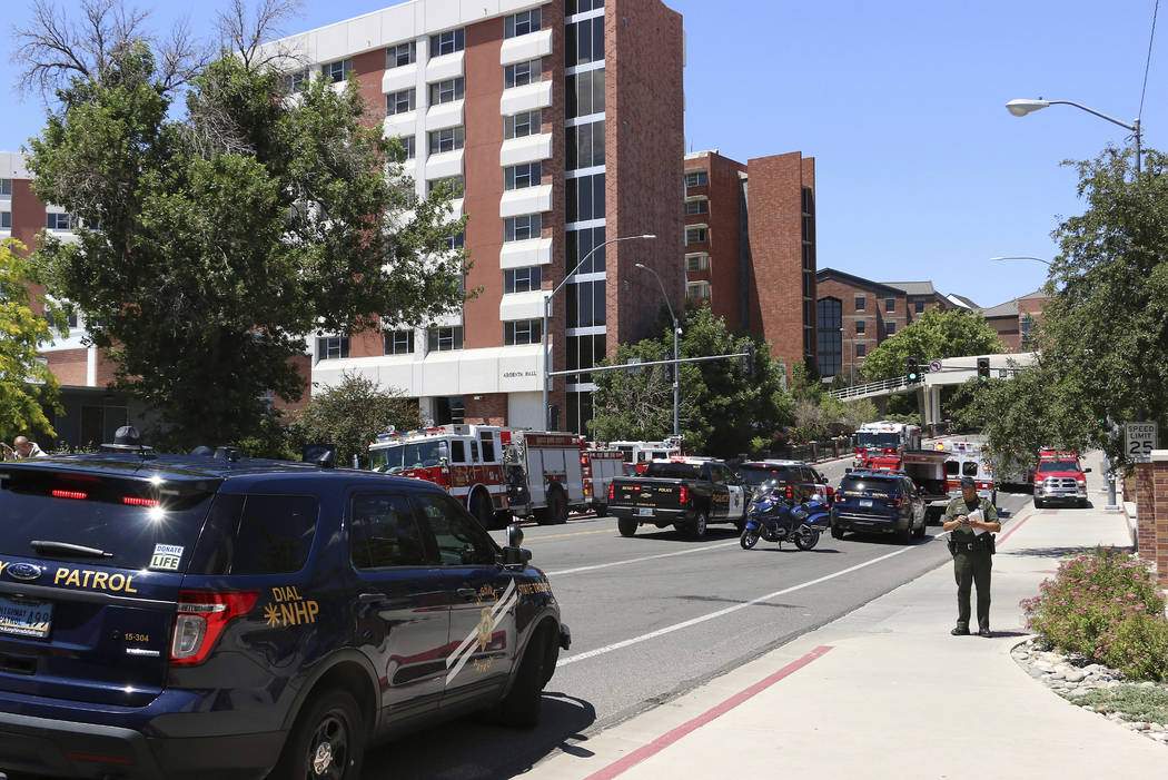 Rescue personnel respond to an explosion that damaged Argenta and Nye Halls on the University o ...