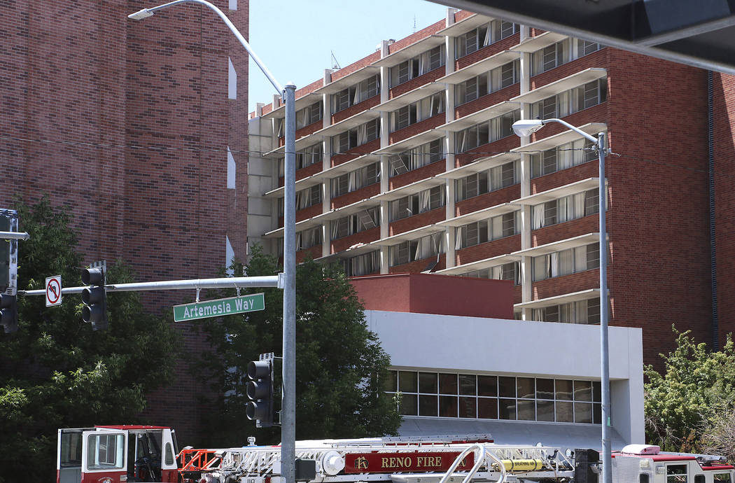 Rescue personnel respond to an explosion that damaged Argenta Hall and Nye Hall on the Universi ...