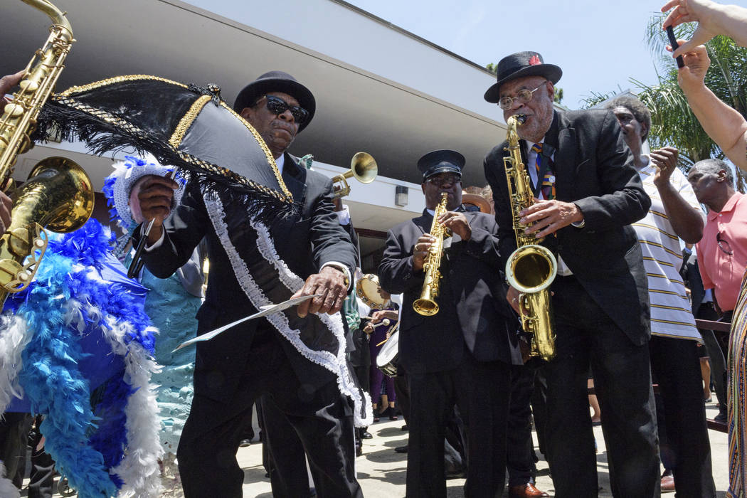 The Treme brass band and attendees dance after pallbearers carried the coffin of Dave Bartholom ...