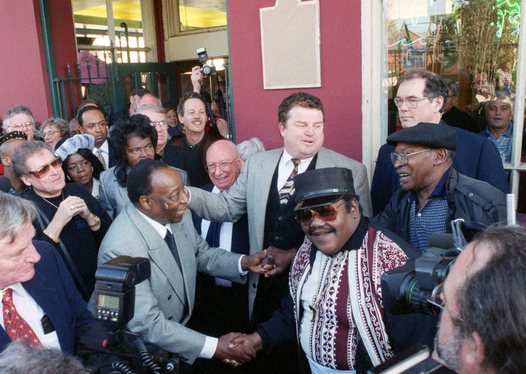 FILE - In a Dec. 10, 1999 file photo, Fats Domino, center right, shakes hands with Dave Barthol ...