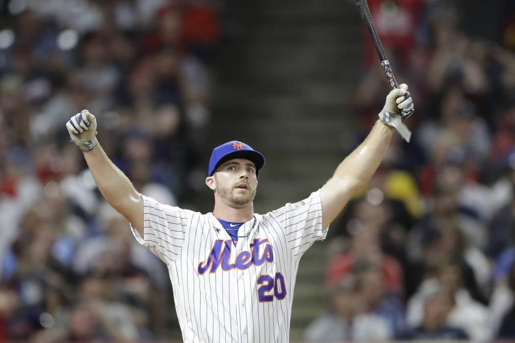 Pete Alonso, of the New York Mets, reacts after hitting during the first round in the Major Lea ...