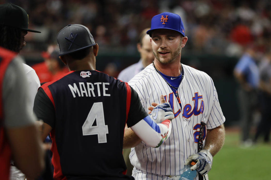 Pete Alonso, of the New York Mets, is congratulated by Ketel Marte, of the Arizona Diamondbacks ...
