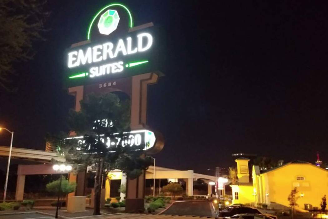Las Vegas police investigate a fatal shooting Monday, July 8, 2019, behind a building at Emeral ...