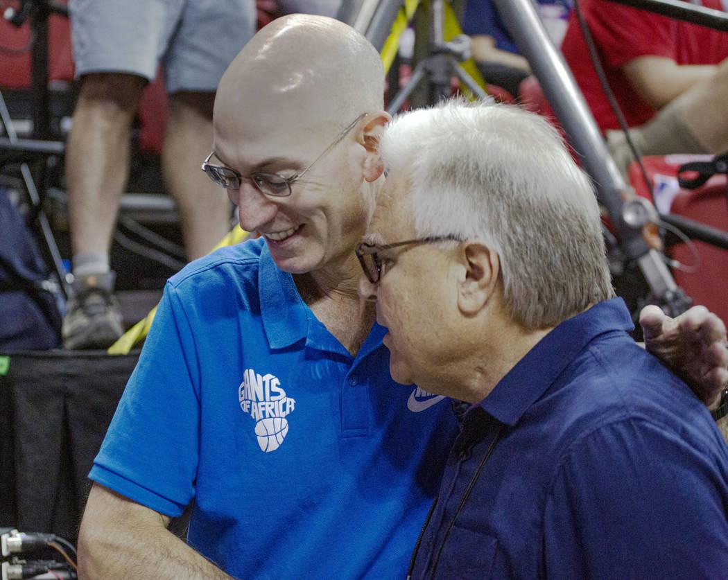 NBA Commissioner Adam Silver talks to Warren LeGarie, Summer League executive director, during ...