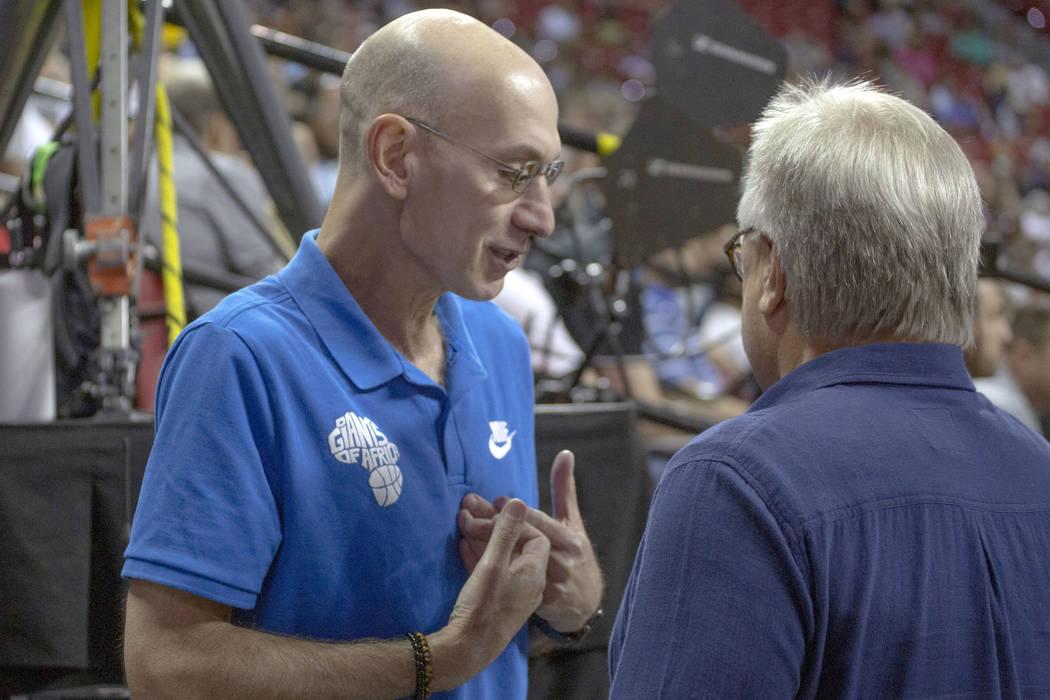 NBA Commissioner Adam Silver, left, talks to Warren LeGarie, Summer League executive director, ...