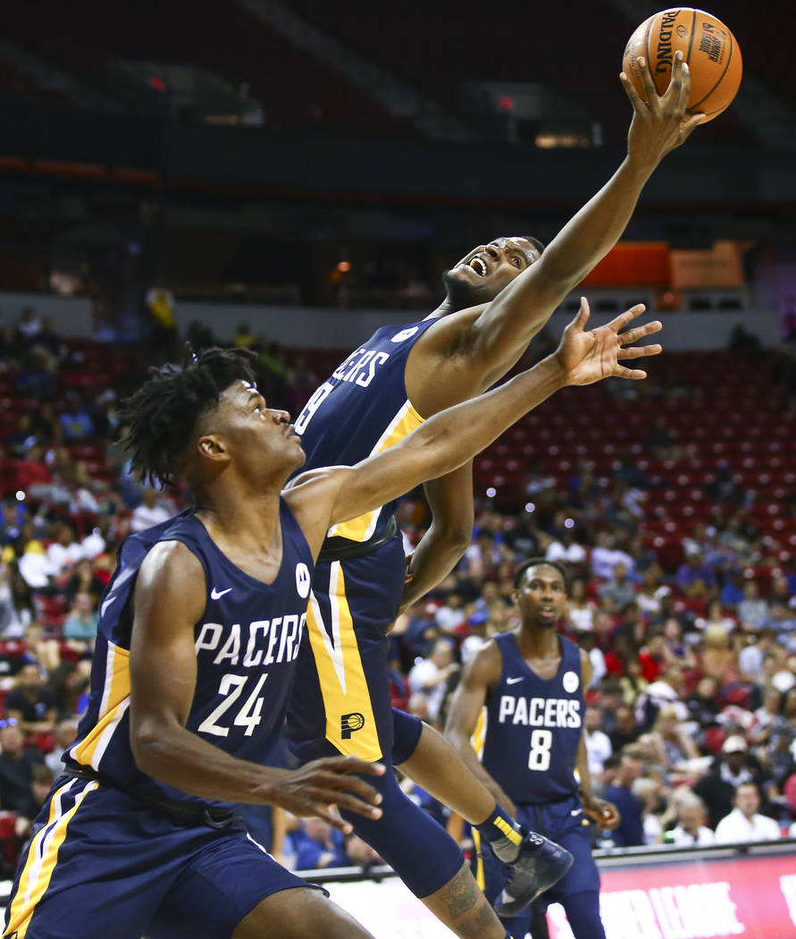 Indiana Pacers' Jaylen Johnson reaches for a rebound over teammate Alize Johnson (24) while pla ...