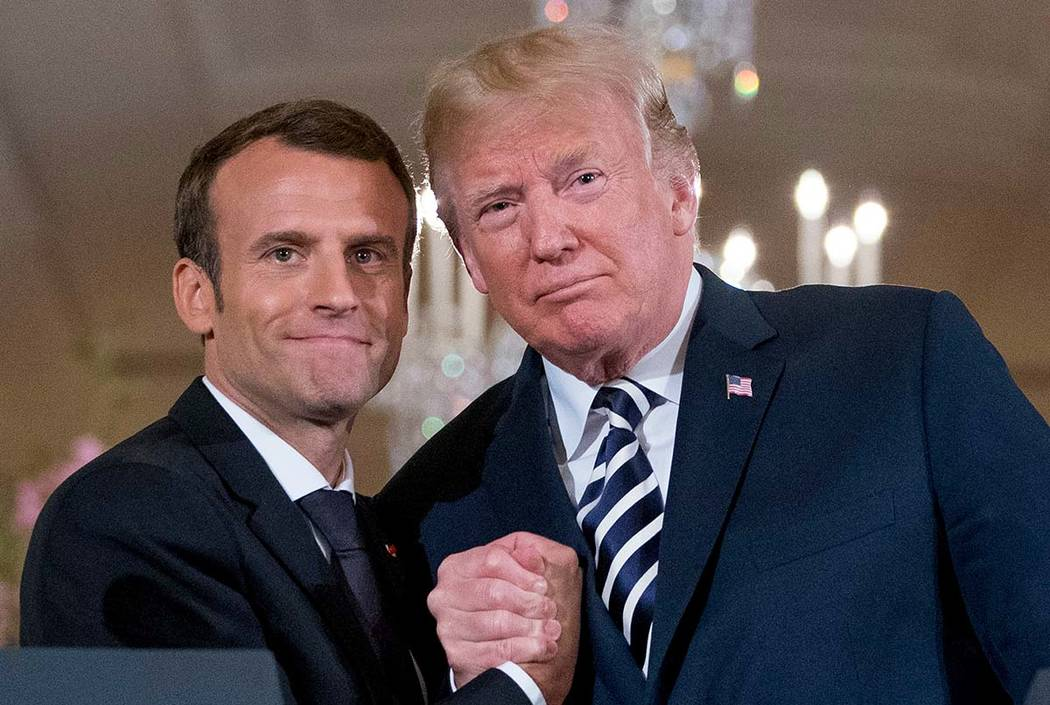 In an April 24, 2018, file photo, French President Emmanuel Macron and President Donald Trump p ...