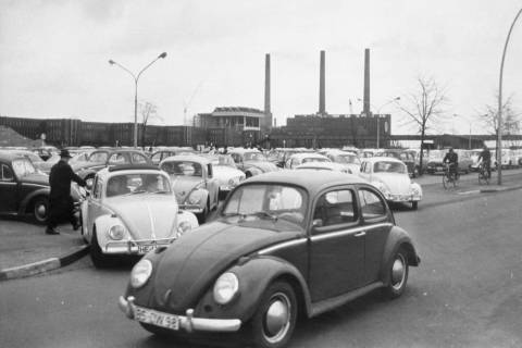 In an April 27, 1966, file photo, Volkswagen workers drive their Beetle cars from the parking l ...