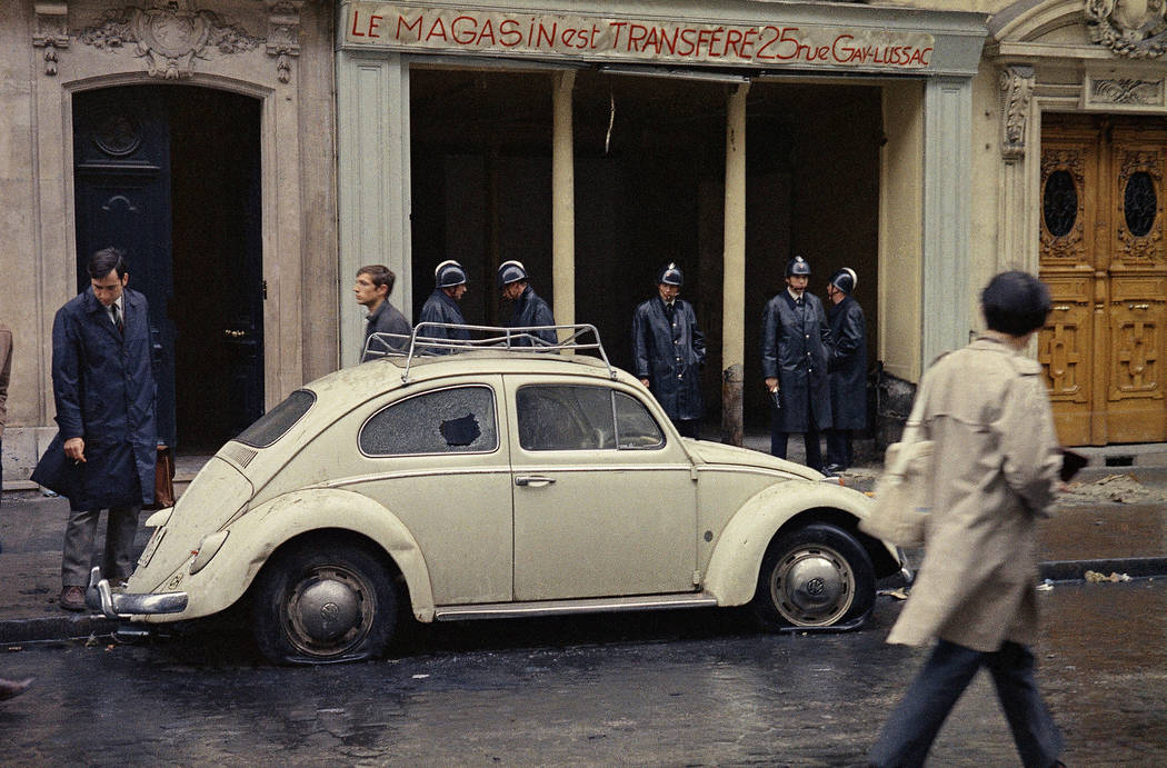 FILE - In this May 11, 1968 file photo, Guards stand in front of a shop on a street in the Lati ...