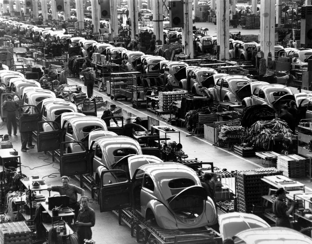 FILE - In this June 16, 1954 file photo, VW beetles are assembled in lines at the Volkwagen aut ...