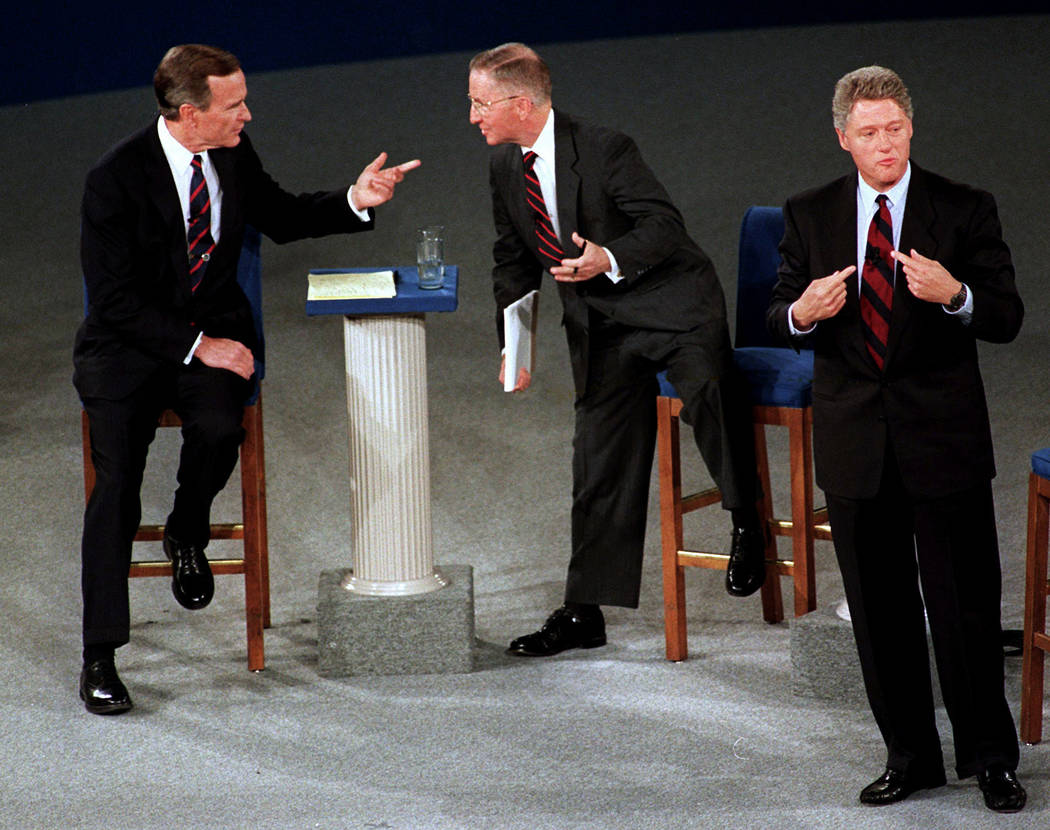President George H.W. Bush, left, talks with independent candidate Ross Perot as Democratic can ...
