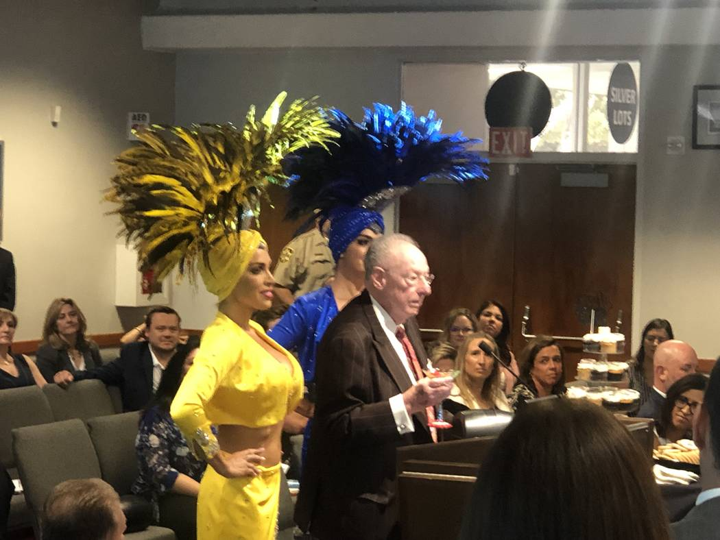 Former Las Vegas Mayor Oscar Goodman is shown with his famed showgirls as he is surprised in a ...