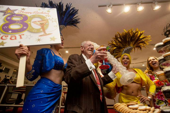 Former Las Vegas Mayor Oscar Goodman celebrates his 80th birthday with showgirls Porsha Revesz, ...