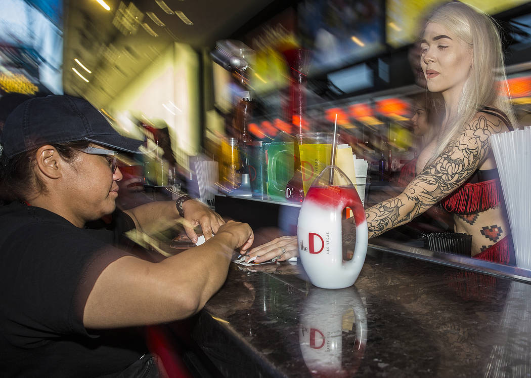 Bartender Hunter Cox, right, serves Kiro Murashige a tropical bliss frozen drink on Friday, Jul ...
