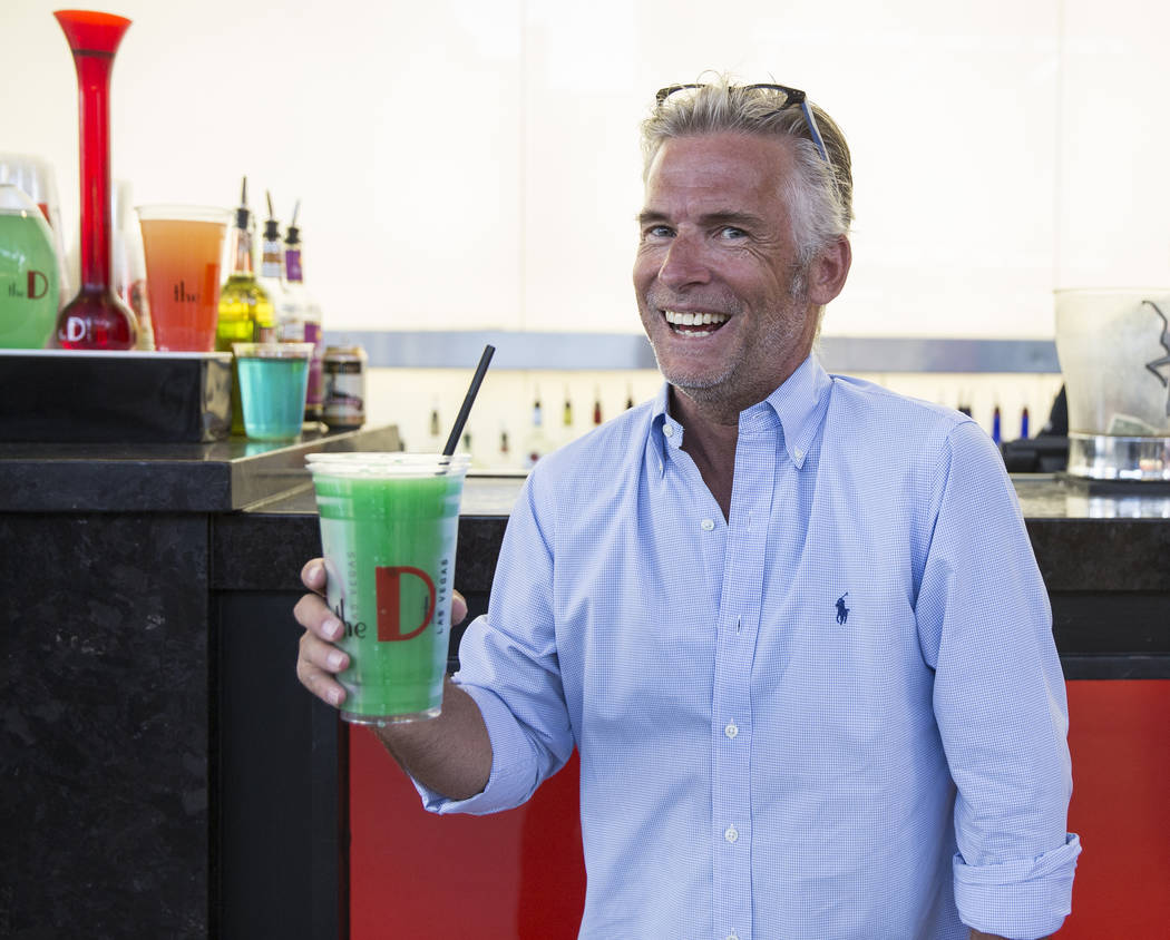 Jason Frankel holds a freshly poured 32-ounce frozen margarita on Friday, July 5, 2019, at the ...