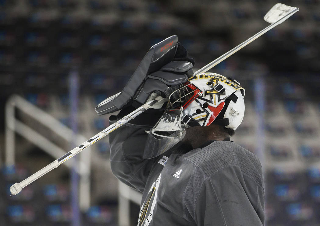 Golden Knights goaltender Malcolm Subban (30) adjusts his mask during practice on Thursday, Apr ...