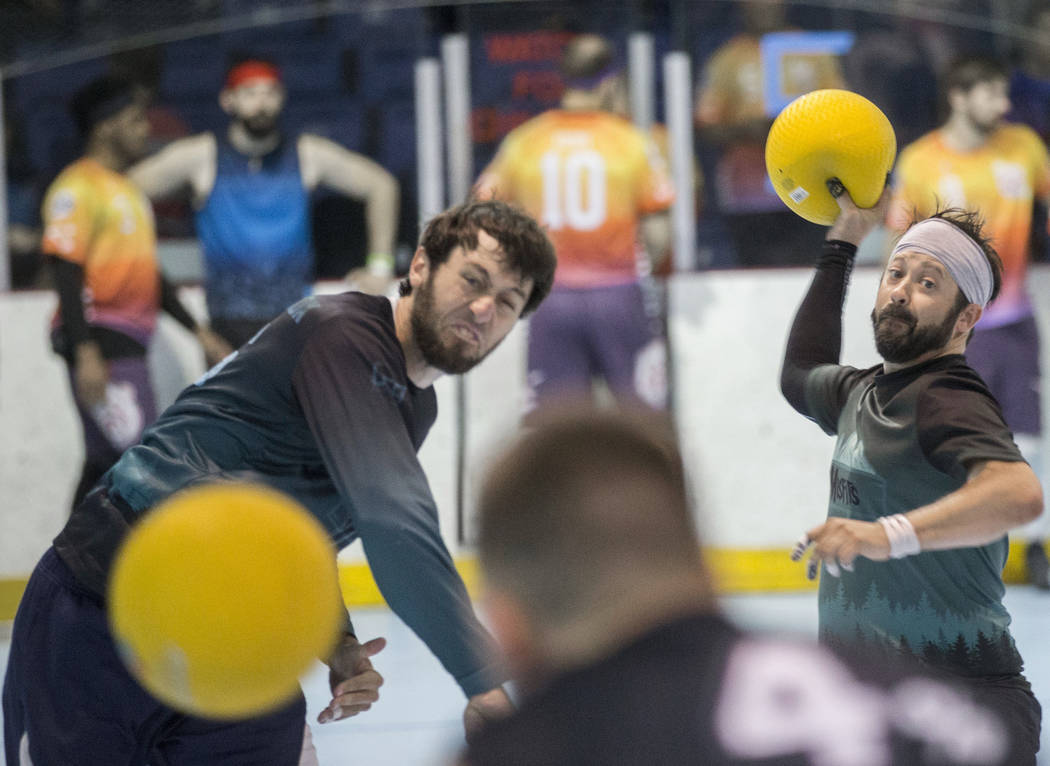 Rob Stiles, right, and Alex Westbrook of team Misfits attack during a two-day, five-division do ...