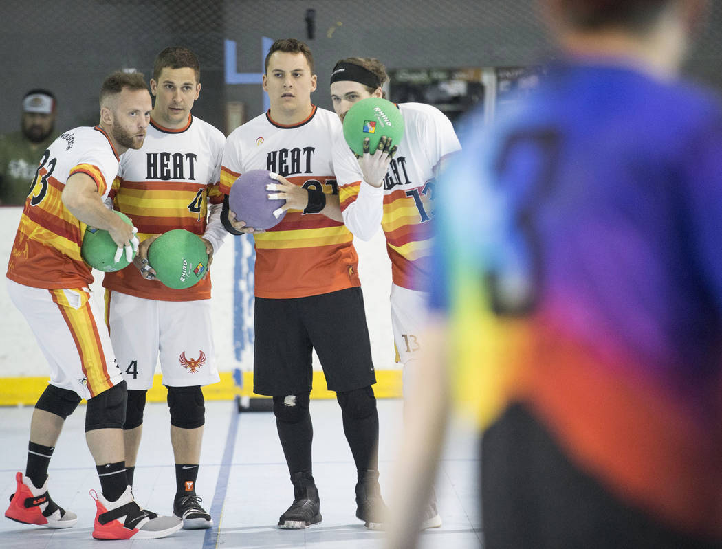 Heat players huddle up before attacking against the Reign Bros during a two-day, five-division ...