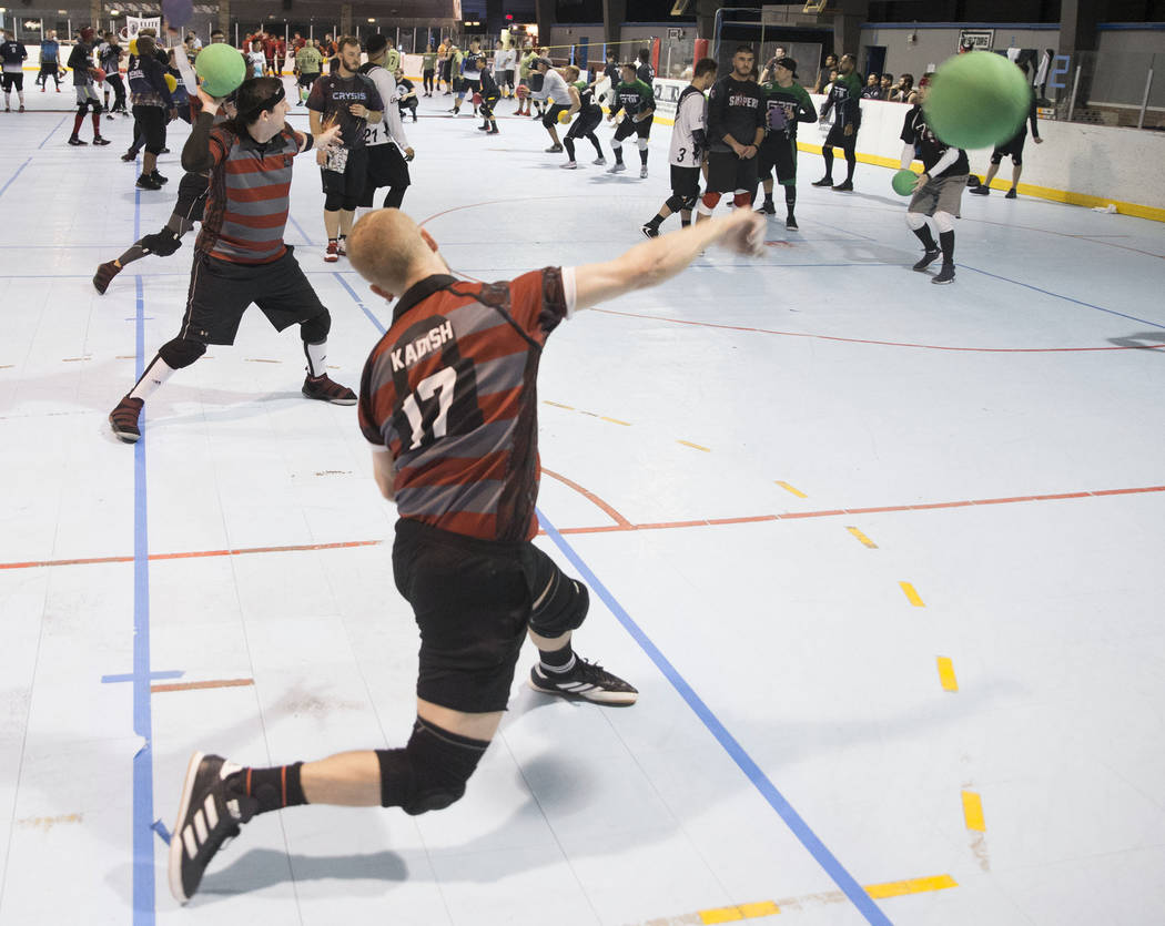 Josh Kadish, front/left, of team Gridlock attacks during a two-day, five-division dodgeball tou ...
