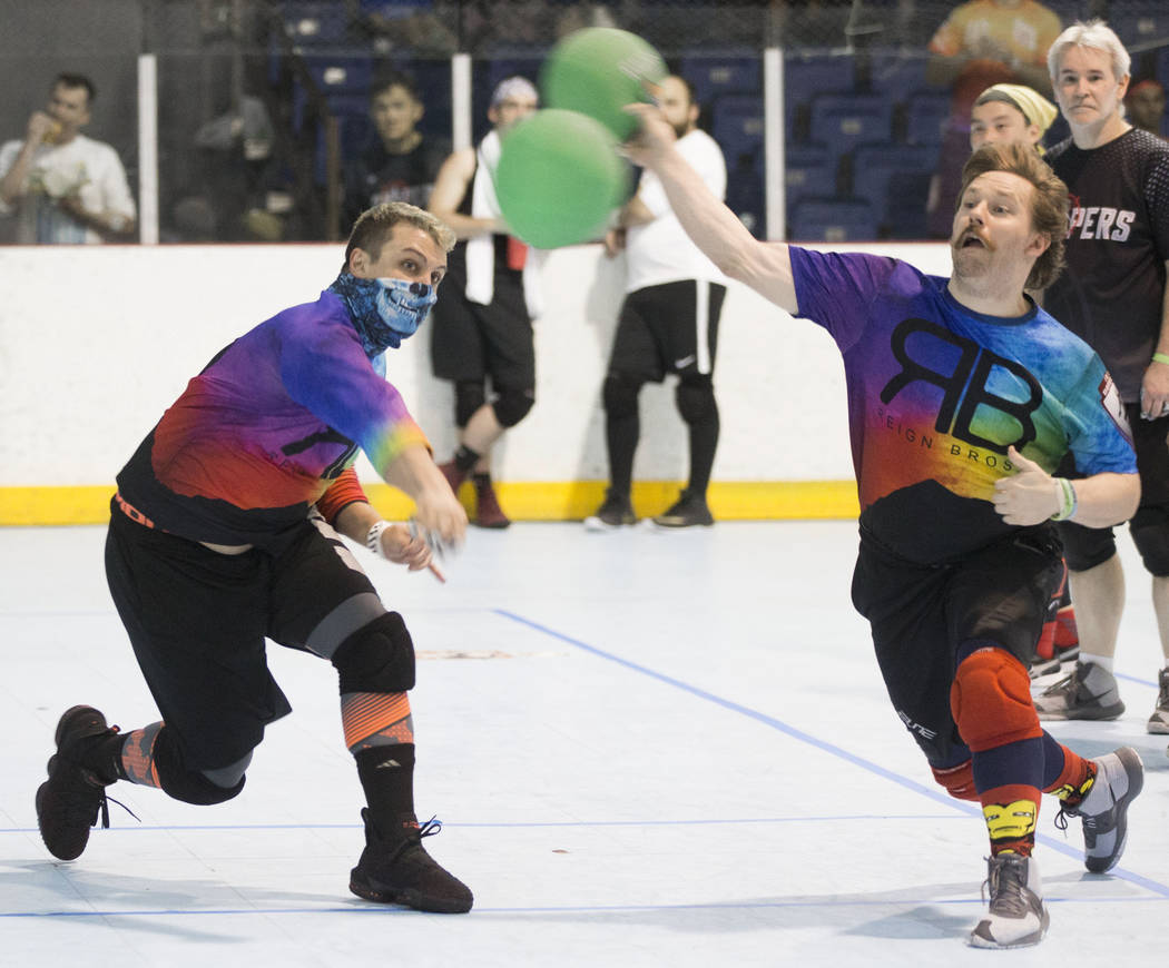 Reign Bros Brandon Cook, left, and Allyn Thomas attack during their match against the Heat at ...