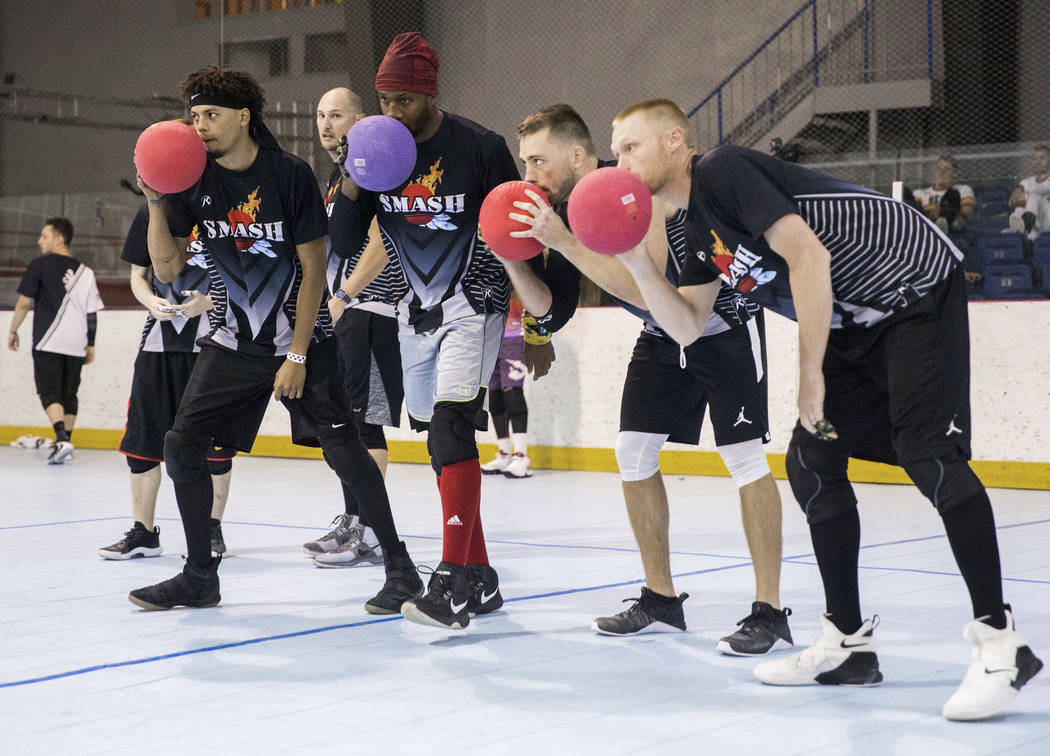 Team Smash huddles up before attacking during a two-day, five-division dodgeball tournament on ...