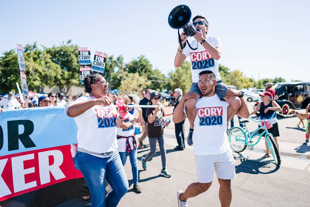 Cory Booker for President organizer ShaRonda Ramos, left, Nevada state director Phil Kim, botto ...