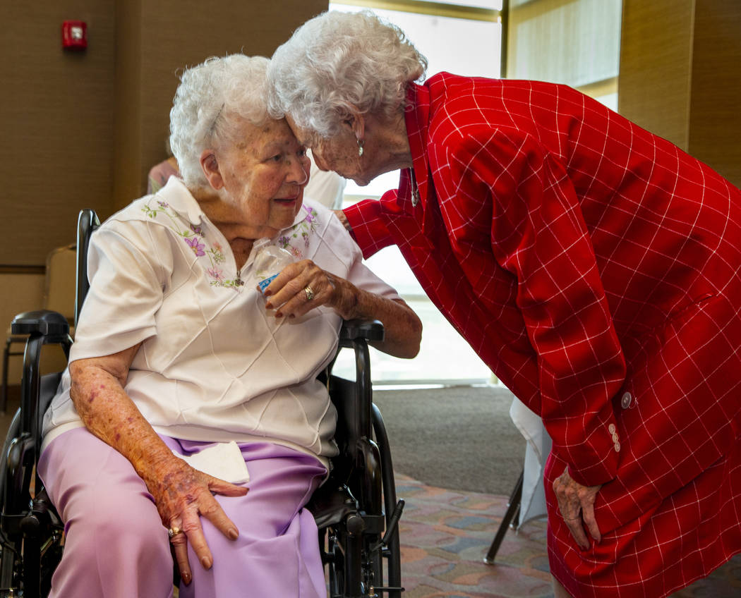 Longtime friends Mary Laub ,left, and Donna Andress reconnect during a renewal of vows ceremony ...