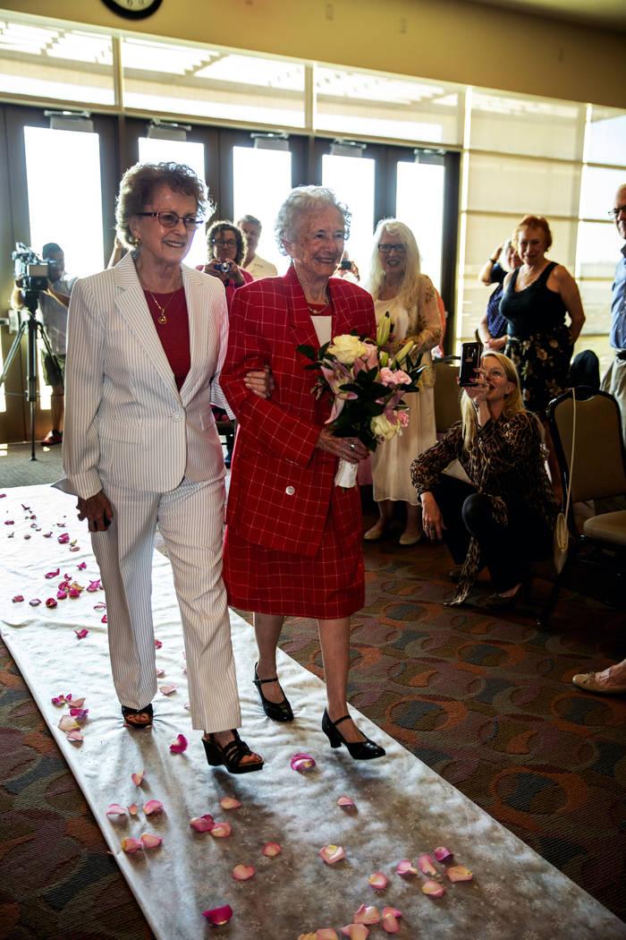Longtime friend Judy Bundorf, left, walks Donna Andress down the aisle to awaiting husband Gail ...