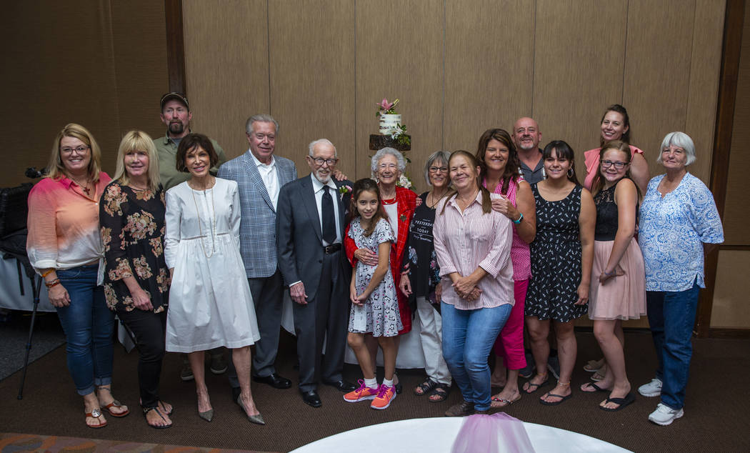 The family gathers for a group shot during a renewal of vows ceremony for Gail and Donna Andres ...