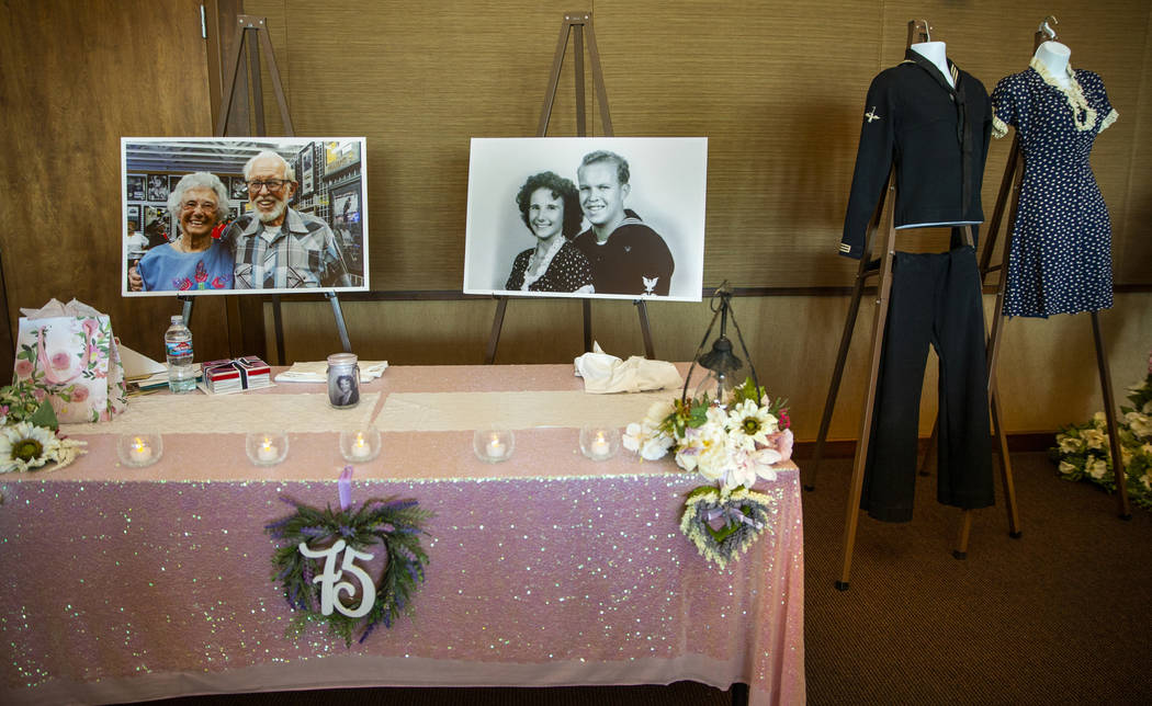Photos of Gail and Donna Andress and their original wedding outfits on display during a renewal ...