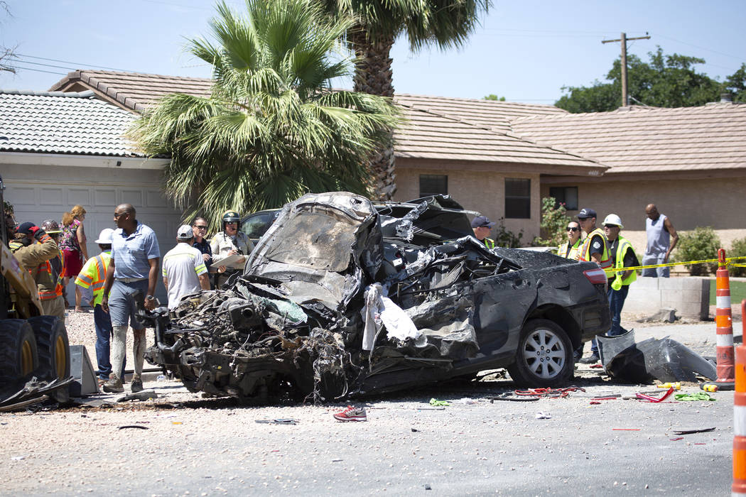 The scene of a fatal crash on West Washington Avenue near Decatur Boulevard on Tuesday, July 9, ...