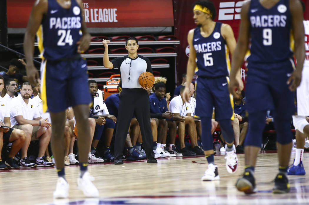 Referee Omar Bermudez, center, motions while officiating a game between Atlanta Hawks and India ...