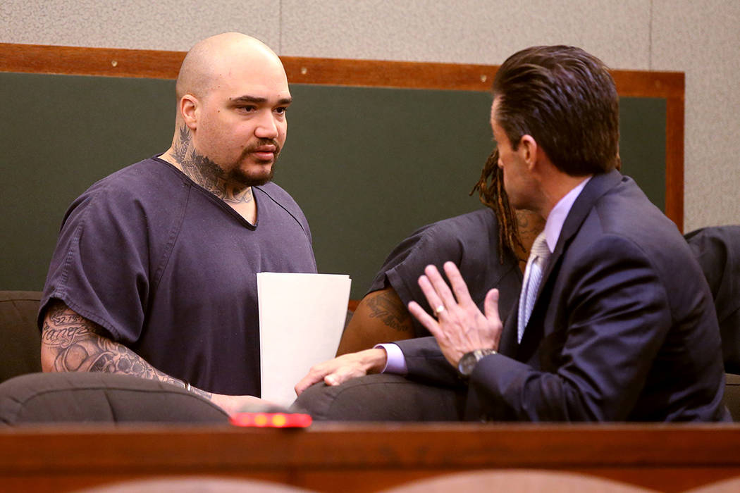 Christopher J. Weygant II, left, talks to his attorney Abel Yanez during a court appearance at ...