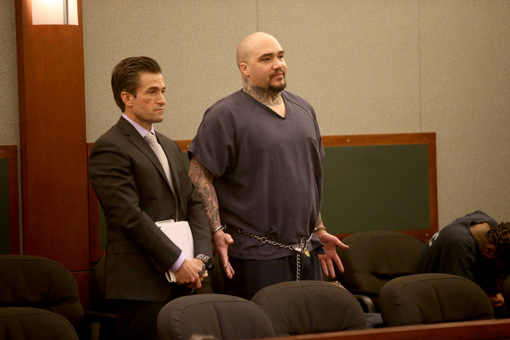 Christopher J. Weygant II, right, appears with his attorney Abel Yanez in court at the Regional ...