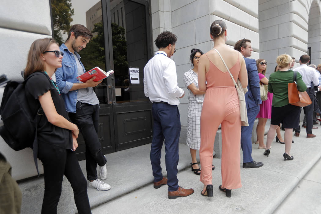 People wait in line to enter the 5th Circuit Court of Appeals to sit in overflow rooms to hear ...