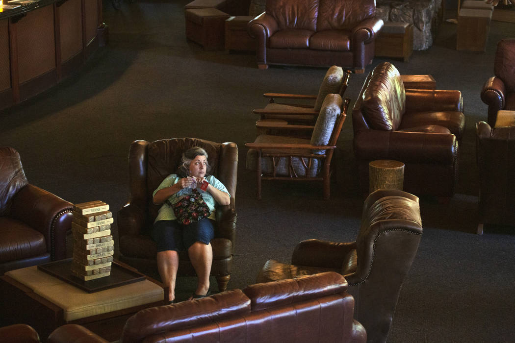Mary, who choose to not give her last name, sits on a couch inside the The Resort on Mount Char ...