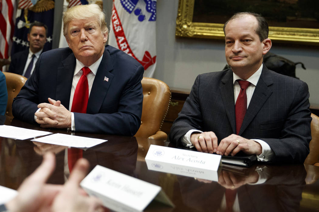 President Donald Trump, left, and Labor Secretary Alexander Acosta listen during a meeting of t ...