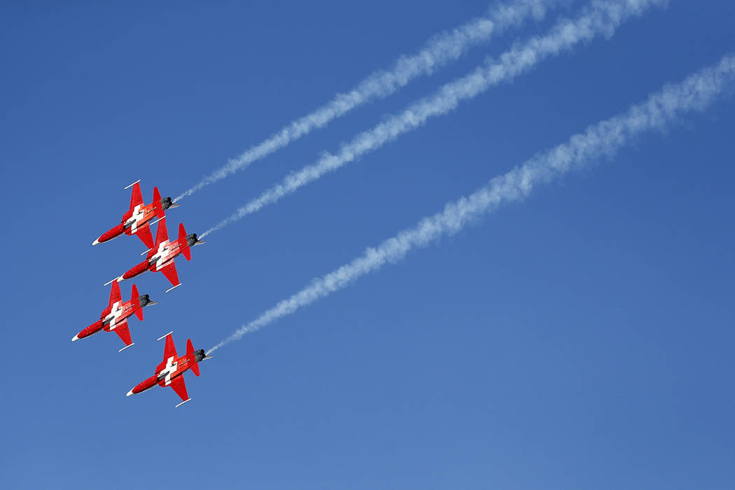 The Patrouille Suisse, an aerobatic team of the Swiss Air Force, flies past ahead of an alpine ...