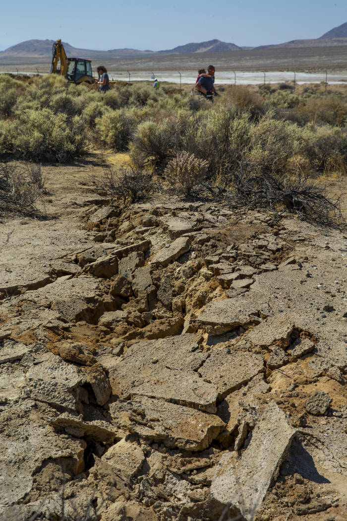Extensive cracks in the desert are coupled with shifting pavement and open cracks due to the ea ...