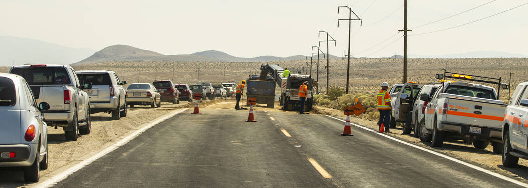 A Caltrans crew continues to repair the extensive cracks which have opened up due to the major ...