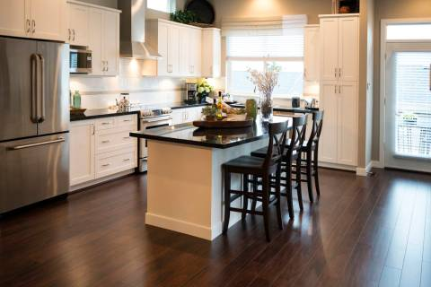 Wood tile works well in kitchens, where it is not susceptible to damage from liquid spills. (Ge ...